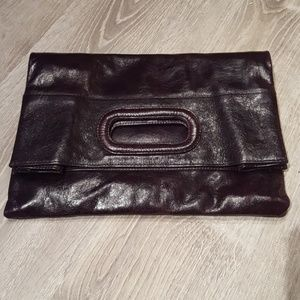 Leather foldover clutch by Sabina